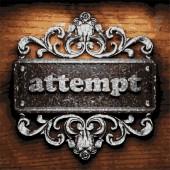 Attempt vector metal word on wood — Stock Vector