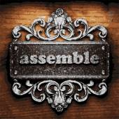 Assemble vector metal word on wood — Stock Vector