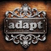 Adapt vector metal word on wood — Stock Vector