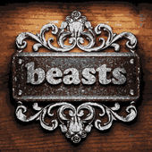 Beasts vector metal word on wood — Stock Vector