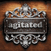 Agitated vector metal word on wood — Stock Vector