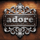 Adore vector metal word on wood — Stock Vector