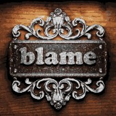 Blame vector metal word on wood — Stock Vector