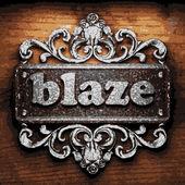 Blaze vector metal word on wood — Stock Vector
