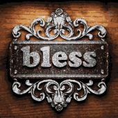 Bless vector metal word on wood — Stock Vector