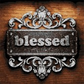 Blessed vector metal word on wood — Stock Vector
