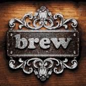 Brew vector metal word on wood — Stock Vector
