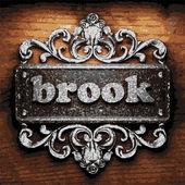 Brook vector metal word on wood — Stock Vector
