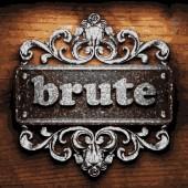 Brute vector metal word on wood — Stock Vector