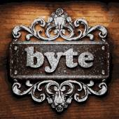 Byte vector metal word on wood — Stock Vector