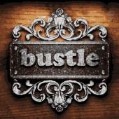 Bustle vector metal word on wood — Stock Vector