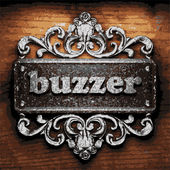 Buzzer vector metal word on wood — Stockvektor