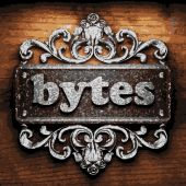 Bytes vector metal word on wood — Stock Vector