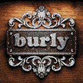 Burly vector metal word on wood — Stock Vector