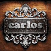 Carlos vector metal word on wood — Stock Vector