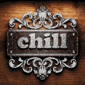 Chill vector metal word on wood — Stock Vector