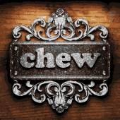 Chew vector metal word on wood — Stock Vector