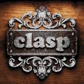 Clasp vector metal word on wood — Stock Vector