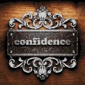 Confidence vector metal word on wood — Stock Vector