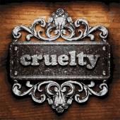 Cruelty vector metal word on wood — Stock Vector