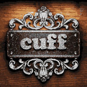 Cuff vector metal word on wood — Stock Vector