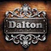 Dalton vector metal word on wood — Stock Vector