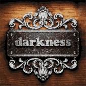 Darkness vector metal word on wood — Stock Vector