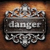 Danger vector metal word on wood — Stock Vector