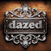 Dazed vector metal word on wood — Stock Vector