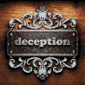 Deception vector metal word on wood — Stock Vector