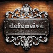 Defensive vector metal word on wood — Stock Vector