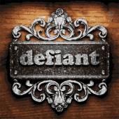Defiant vector metal word on wood — Stock Vector