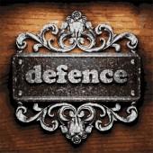 Defence vector metal word on wood — Stock Vector