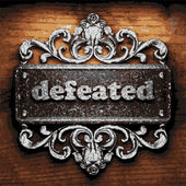 Defeated vector metal word on wood — Stock Vector