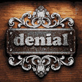 Denial vector metal word on wood — Stock Vector