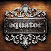 Equator vector metal word on wood — Stock Vector