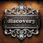 Discovery vector metal word on wood — Stock Vector