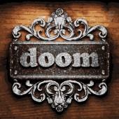 Doom vector metal word on wood — Stock Vector