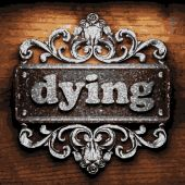 Dying vector metal word on wood — Stock Vector