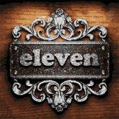 Eleven vector metal word on wood — Stock Vector
