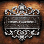 Encouragement vector metal word on wood — Stock Vector