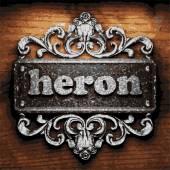 Heron vector metal word on wood — Stock Vector