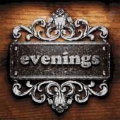 Evenings vector metal word on wood — Wektor stockowy