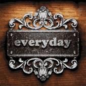 Everyday vector metal word on wood — Stock Vector