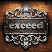 Exceed vector metal word on wood — Stock Vector