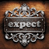 Expect vector metal word on wood — Stock Vector