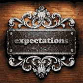 Expectations vector metal word on wood — Stock Vector