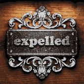 Expelled vector metal word on wood — ストックベクタ