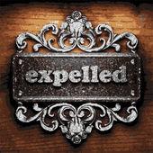 Expelled vector metal word on wood — Wektor stockowy