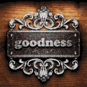 Goodness vector metal word on wood — Stock Vector
